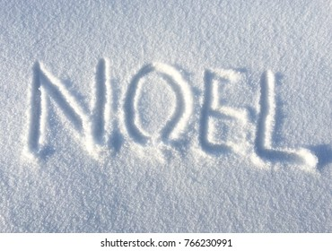 Noel letters, hand drawn on fresh snow