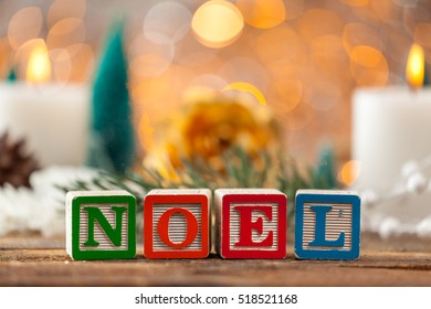 Noel Written With Toy Blocks On Christmas Card Background With Copy Space.