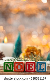 Noel Written With Toy Blocks On Christmas Card Vertical Background With Copy Space.