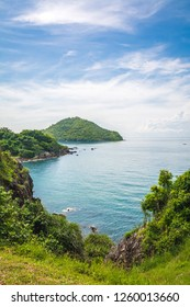 Noen Nangphaya Viewpoint, the famous viewpoint and new landmark of Chanthaburi, Thailand. This viewpoint to see the mountains, rocky cliff, islands and sea scenery with blue sky (Vertical)