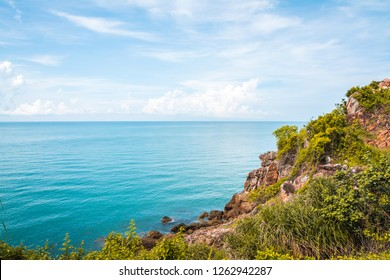 Noen Nangphaya Viewpoint, the famous viewpoint and new landmark of Chanthaburi, Thailand. The viewpoint to see the mountains, rocky cliff, and sea scenery with blue sky, sunlight