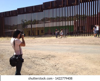 Nogales, Ariz. / US - June 11, 2013: Media cover a bittersweet reunion through the US-Mexico fence between DACA recipients and parents who've been deported.