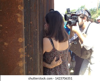 Nogales, Ariz. / US - June 11, 2013: Journalists document a bittersweet reunion between Dreamer Evelyn Rivera and her mother, deported earlier, at the US-Mexico border fence.