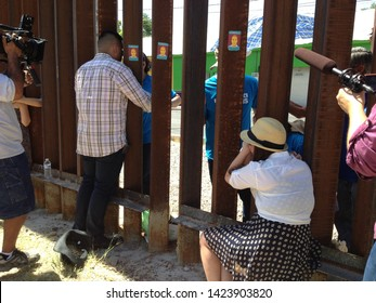Nogales, Ariz. / US - June 11, 2013: Journalists document a bittersweet reunion between Dreamer Renata Teodoro and her mother, deported earlier, at the US-Mexico border fence.