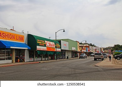 Nogales, Arizona, USA – May 1, 2018:  Downtown street with businesses in Nogales, Arizona, USA with copy space.