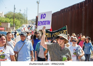NOGALES, AZ - OCTOBER 08: Supporters and veterans protesting deportation policies at the United States and Mexico border on October 08, 2016 in Nogales, AZ, USA.