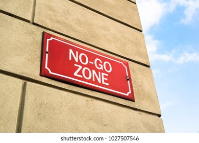 No-go zone - street signboard with notification -  dangerous and unsafe part of city and town. Ghetto with hign criminality and delinquency