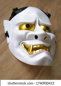 Noh Theatre - A Japan traditional  white demon mask, Hanya on wood floor                             - Shutterstock ID 1740900413