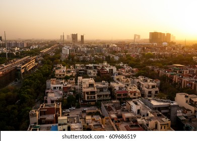 Noida cityscape at dusk with the under construction buildings and golden sunset light