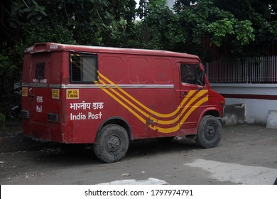 """Noida,UP / India - 08152020: Red Post office van used for postal delivery service in the Indian post office"""