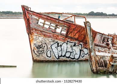 The Noirmoutier boats cemetery. The bow of the wreck of an old wooden fishing boat stranded and do not float at high tide.