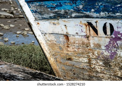 The Noirmoutier boats cemetery. Close up on the bow of the wreck  of an old wooden fishing boat