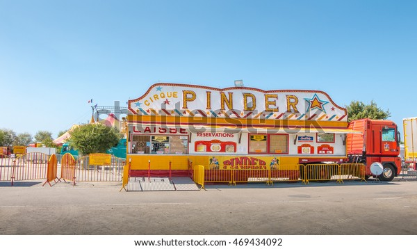 Noirmoutier, France - August 15, 2016 : installing the Pinder circus in a parking lot of Noirmoutier, France, during the summer 2016 - ticketing of circus Pinder