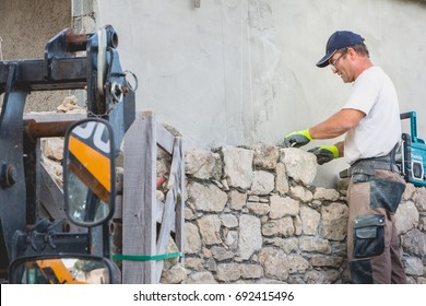 NOIRMOUTIER, FRANCE - june 16, 2017: mason renovates a house with stone in the tradition of NOIRMOUTIER, FRANCE