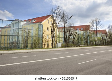 A Noise Barrier Made Of Large Glass Panels Protects A Newly Constructed  Apartment Building From The