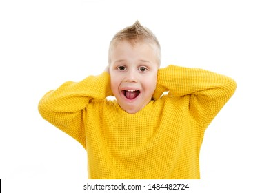 Noise, stress and people concept - stressed boy in yellow sweater closing ears by hands over white background
