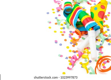 Noisemakers, streamers and confetti. Isolated on white background.