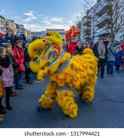 Noisy-le-Grand, France - February 18,2018: The yellow Chinese Lion performing in the street during the Chinese New Year parade in Nosy-le-Grand on February 18,2018.