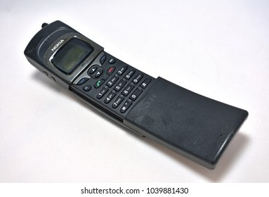 Nokia 8110 banana mobile phone displayed on white background in Bangkok on March 6, 2018.