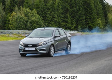 NOKIA, FINLAND - August 17, 2017: Test car performs a braking test at a proving ground with ABS shut off. Car braked to stand still with locked front wheels and produced smoke from its front tyres.