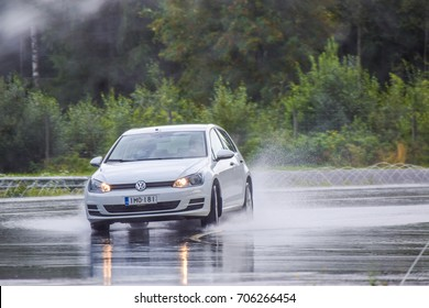 NOKIA, FINLAND - August 22, 2017: Tire test is held at the proving ground. Professional test-driver performs wet handling test to determine the tire which provides the best grip with wet road.