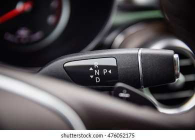 NOKIA, FINLAND - AUGUST 25, 2016: Mercedes-Benz GLC 350 e Plug-In Hybrid at the test-drive. Close up photo of the automatic gearbox shift knob placed on a steering wheel column.