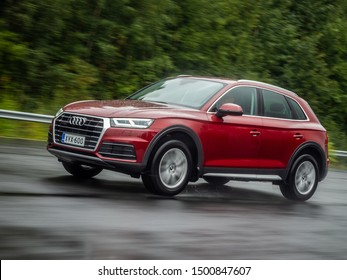 NOKIA, FINLAND - AUGUST 25, 2019: Audi Q5 35 TDI Quattro 2019 model year drives on a wet asphalt road during light rain on a cloudy day.