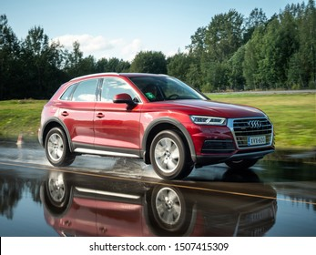 NOKIA, FINLAND - AUGUST 25, 2019: Audi Q5 35 TDI Quattro 2019 model year drives on a wet asphalt road on a sunny day.