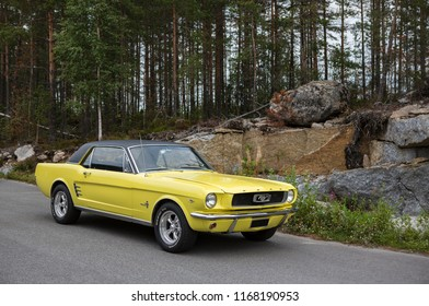 NOKIA, FINLAND - August 26:  First generation Ford Mustang parked outdoor. Black vinyl roof. Muscle car from USA. Image taken in Nokia, Finland on August 26, 2018.