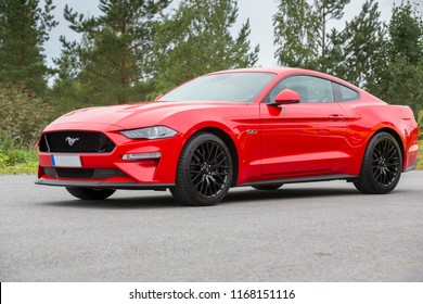 NOKIA, FINLAND - August 26:  The new Ford Mustang. Red sports car, real American muscle car. Image taken in Nokia, Finland on August 26, 2018.