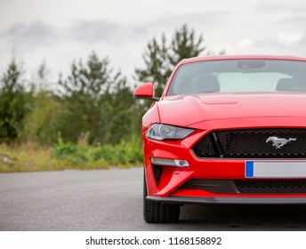 NOKIA, FINLAND - August 26: The new Ford Mustang, Red sportswear from USA. Pony car shining. Image taken in Nokia, Finland on August 26, 2018.