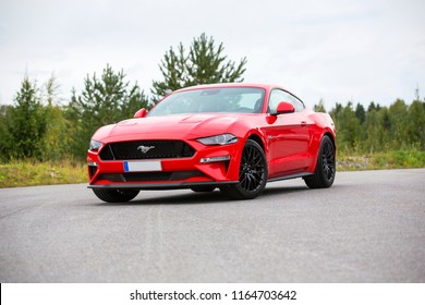 NOKIA, FINLAND - August 26:  Red Ford Mustang, newest model parked. Sporty legendary American sportscar with big black wheels. Image taken in Nokia, Finland on August 26, 2018.