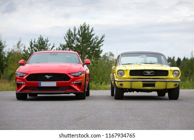 NOKIA, FINLAND - August 26:  Two Ford Mustangs parked. Front side comparison. Newest model against the first generation Mustang. Image taken in Nokia, Finland on August 26, 2018.