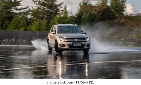 NOKIA, FINLAND - August 27, 2018: Volkswagen Tiguan skidds on a slippery wet road on a prooving ground during tire tests. Skidding is a handling condition where one or more tires are slipping.