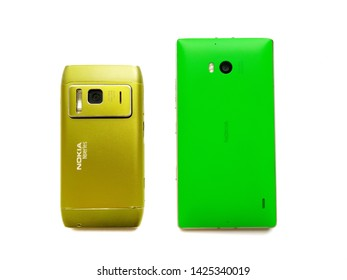 Nokia Lumia 930 or Nokia N8 isolated on white background. Comparison between Old and New Nokia smartphone, mobile together. Keypad or touchscreen mobile phone together. New Delhi/India June 16, 2019.