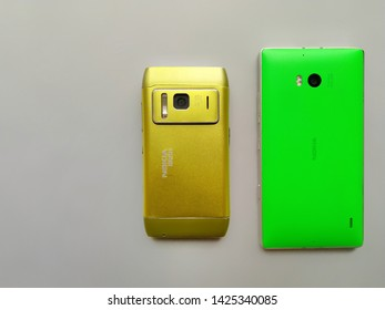 Nokia Lumia 930 or Nokia N8 isolated on Grey background. Comparison between Old and New Nokia smartphone, mobile together. Keypad or touchscreen mobile phone together. New Delhi/India June 16, 2019.