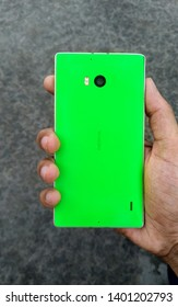 Nokia Lumia 930, old Nokia Lumia limited smartphone. Hand of a person showing Nokia smartphone. One of Nokia's most popular phones. Window phone. New Delhi, Delhi/India - may 30, 2019.