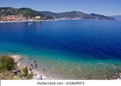 NOLI, LIGURIA - JUNE 2019: panoramic view of the Liguria coast with the beautiful blue colors of the sea and the village of Noli on the background