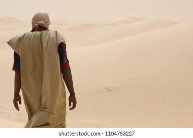 Nomad goes through the desert. Sahara full of sunshine.