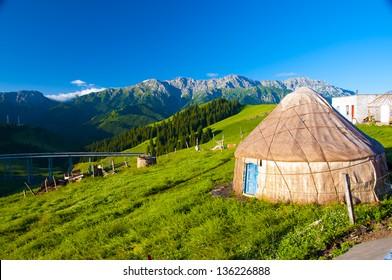 Nomadic Yurt with Tianshan Range in the background, Xinjiang