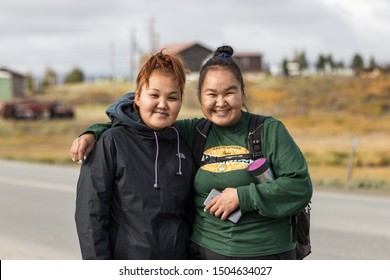 Nome, Alaska, USA - September 10th, 2019: Portrait of two native inuit - eskimos women looking camera, outdoors on Seppala Dr in Nome, Alaska.