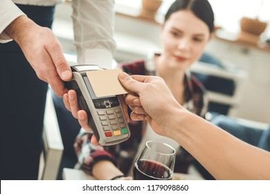 Non cash transaction. Selective focus of a credit card being pressed to a money terminal