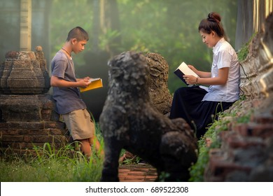 Non formal education, Sister teaching book brother.