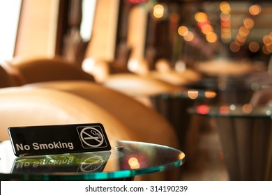 Non smoking sign on a table in a cafe