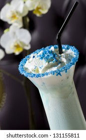 Non-alcoholic cocktail with whipped cream and blue curacao