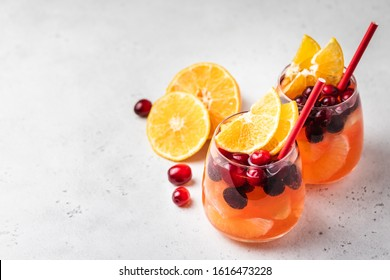 Non-alcoholic cranberry orange spritzer. Selective focus, copy space.