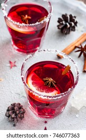 Non-alcoholic mulled wine with lemon and cinnamon in glass glasses, selective focus