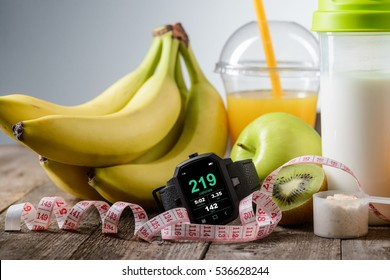 Non-caloric food for staying fit and with great curves. Sports watch to keep a training organized, tape-measure to look after the waist and tasty fruits with a special shaker.
