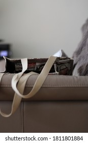 Nonchalant bag on couch with blurry background.