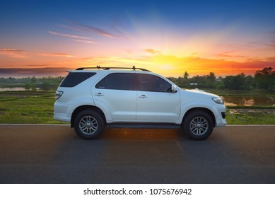 Nong Bua Lamphu Province, Thailand : Toyota Fortuner parking on the road and sunrise